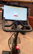 A PELOTON TRAINING BIKE with Peloton console model PLTN-RB1VQ complete with power lead and lock -