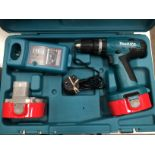Makita 8391D 18v cordless hammer drill in case complete with charger and two batteries