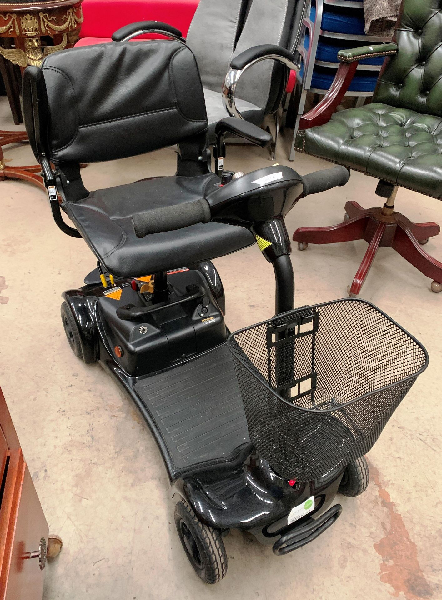 An Electric Mobility Euro Ltd Ultralite 480 mobility scooter complete with keys, manual,