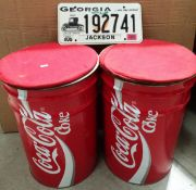 2 x Coca Cola can style metal stools and an American registration plate