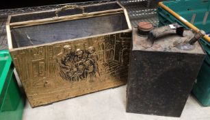 Black vintage petroleum can and a brass and wooden magazine holder