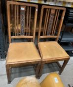 A set of four 1930's carved oak dining chairs with brown rexine seats