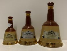 Three graduated Wade Ceramic Bell's Old Scotch Whisky decanters (no contents) - 6 2/3fl oz - 75cl