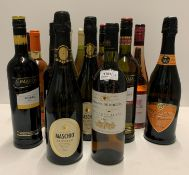 Seventeen various bottles including a 50cl bottle of De Kuyper Cherry Brandy,