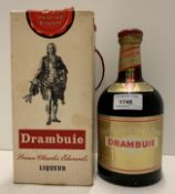 A bottle of Prince Charles Edwards Drambuie liqueur in presentation box compete with paper wrapper