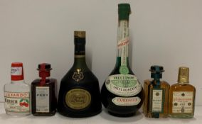 A bottle of Domecq Marques de Domecq Reserva Real brandy (seal broken),