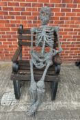 A lifesize wirework model of a seated skeleton total height approx 130cm