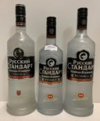Two 100cl bottles of Pyccknn Ctahdapt Russian Standard Vodka (38% volume) and a 70cl bottle of the