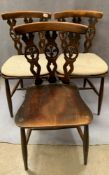 A set of six Ercol dark elm dining chairs,