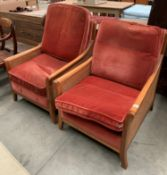 Two Parker Knoll Bergere style medium wood finish armchairs with pink upholstered seat and back