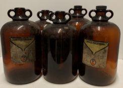 Five brown glazed demi johns,