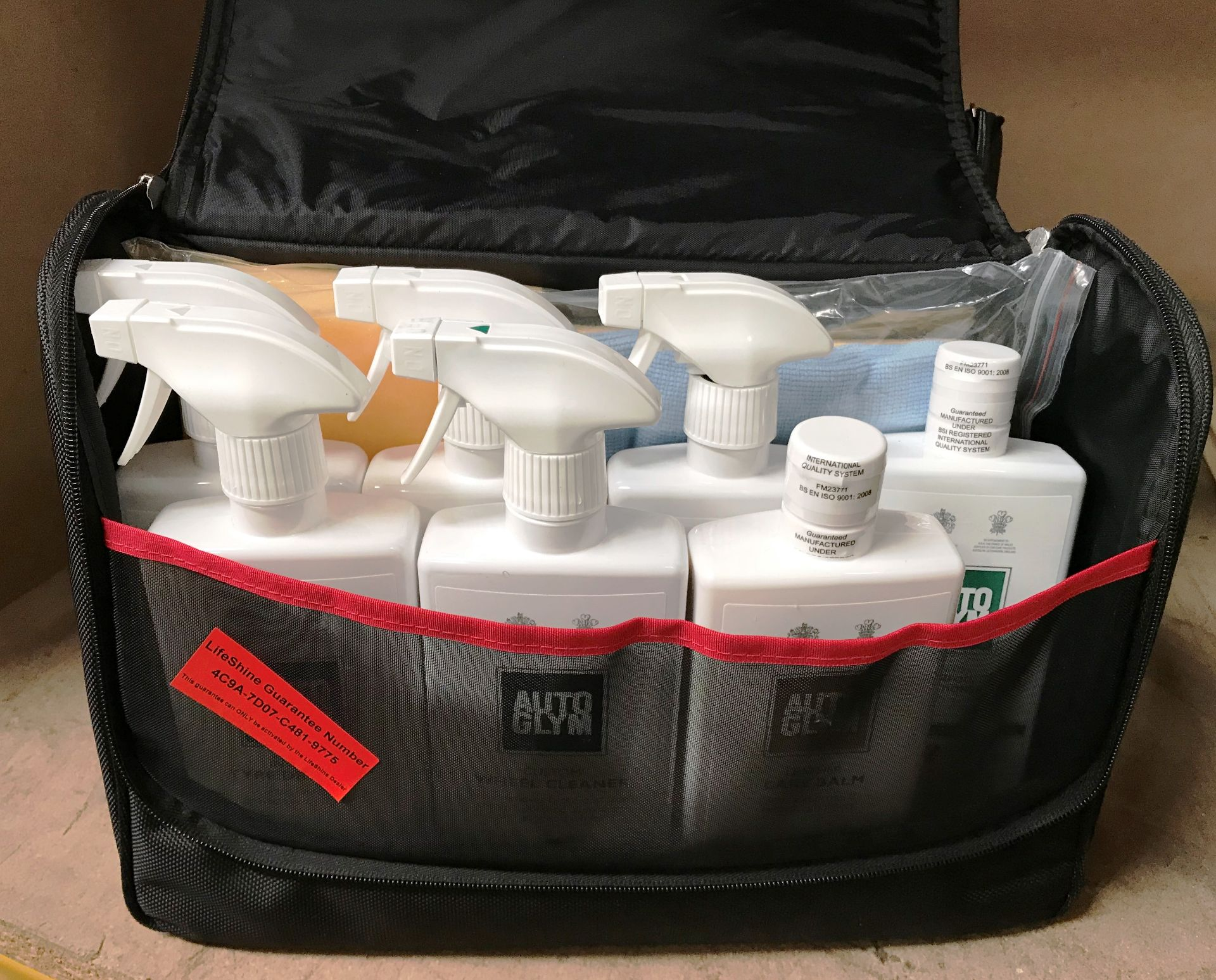 An Auto Glym Lifeshine Aftercare Collection car valeting bag and contents - 500ml Interior Shampoo,