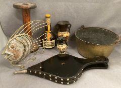 A brass jam pan, a large wooden bobbin, metal fish,