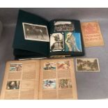 A post card album containing approximately 75 black and white and colour topographical and other