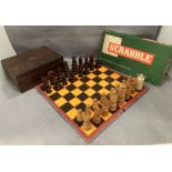 A wood chess set with one replacement castle and several pieces damaged complete with a walnut box