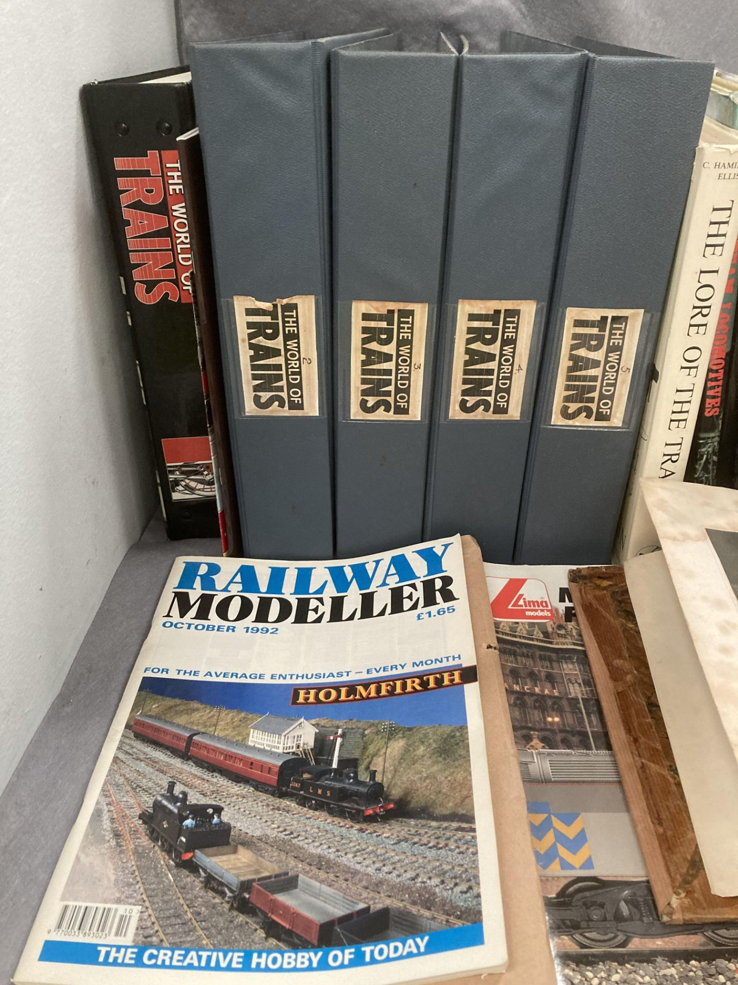 Contents to two boxes - five folders containing the world of trains magazines and other books and - Image 2 of 4