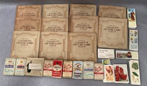 Eleven small Wills cigarette picture card albums containing Players 'Wild Birds',