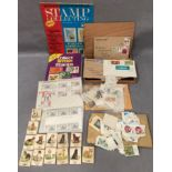Contents to tray - two stamp collecting magazines,