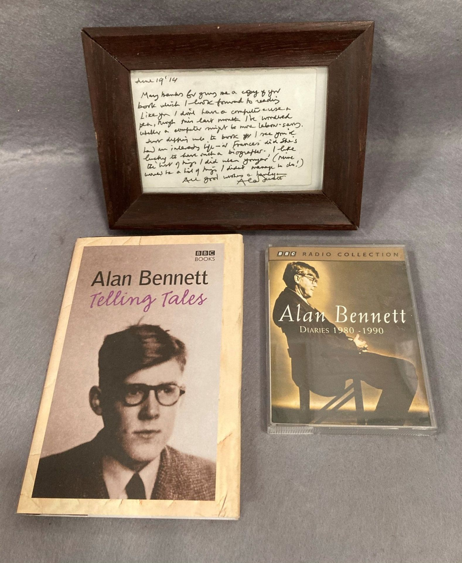 A small hand written note signed Alan Bennett and dated June 19th fourteen in oak frame thanking