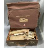 A Monte Carlo Rally brown canvas messenger bag and a small brown fibre suitcase containing a