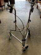 A Roma Medical chrome framed three wheel mobility walking aid