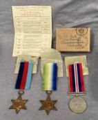 Three Second World War medals and ribbons in a box addressed to Mr. S.