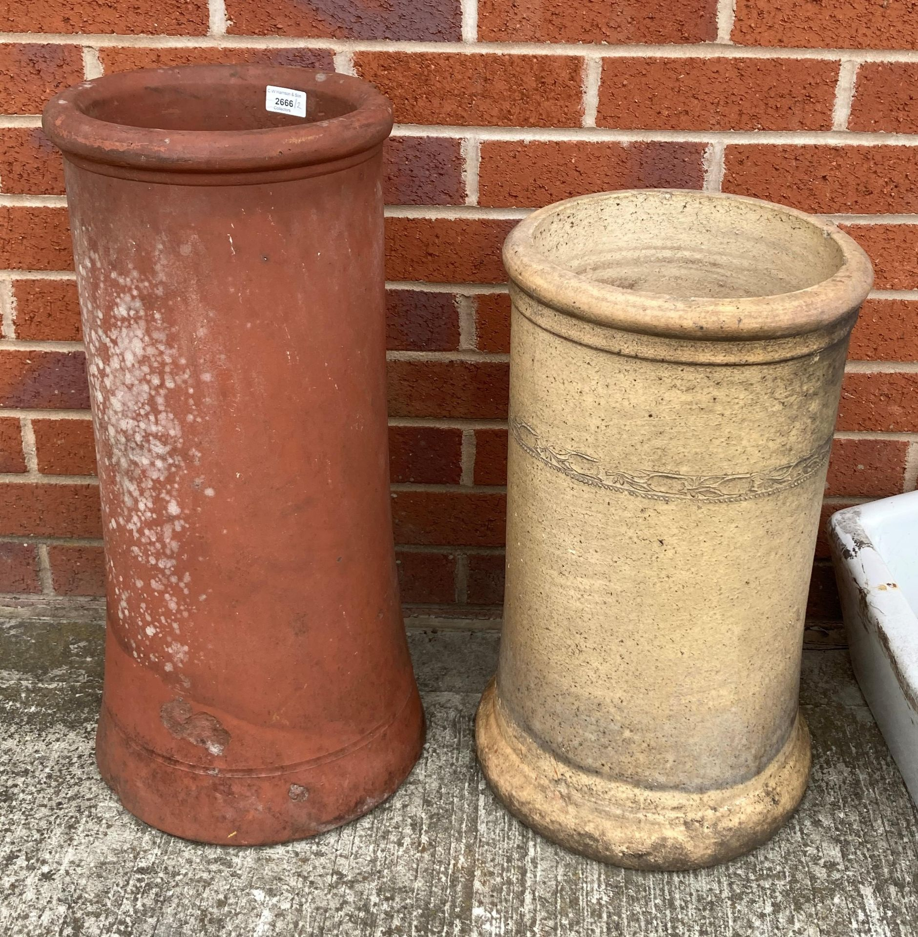 A terracotta chimney pot - damaged 62cm high and a cream earthenware chimney pot 52cm high