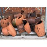Contents to pallet nine salt glazed and terracotta chimney cowls approx heights 30-45cm