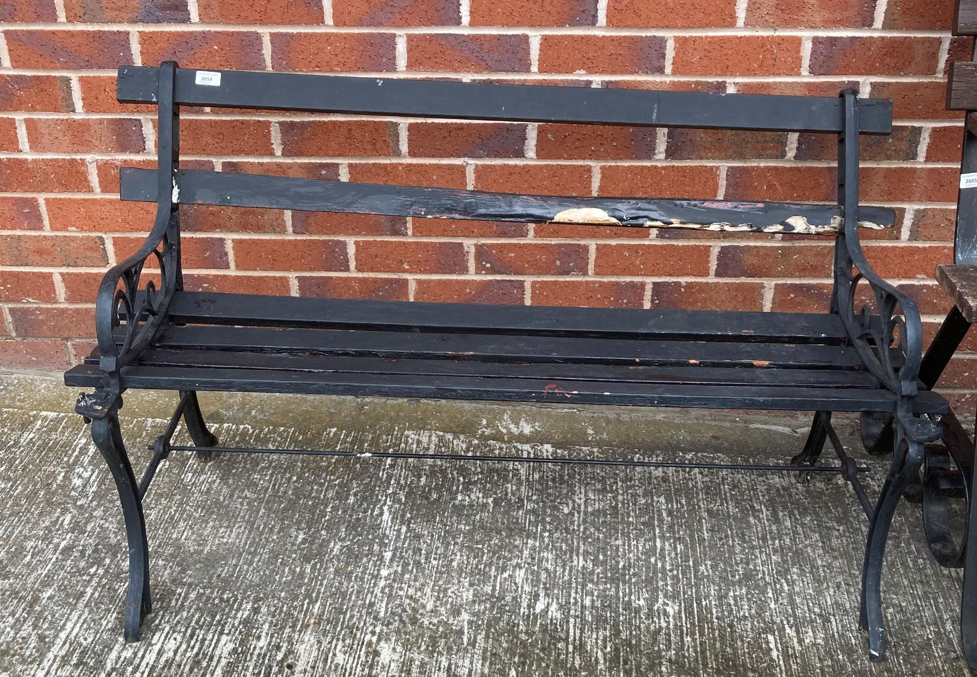 A lightweight metal framed outdoor bench with black painted wood slats 120cm long