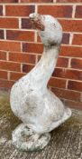 A white painted concrete goose - repair to neck 62cm high