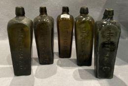 Five brown glass gin bottles each 25cm high - V. Hoytema and Co.
