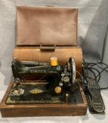 A Singer 240v portable sewing machine complete with foot pedal and a small brown fibre suitcase