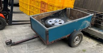 A small single axle box trailer, metal framed with wood sides and base (base needs repairing),