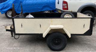 A cream metal framed wood panelled single axle trailer, 200cm x 47==124cm x 47cm deep,