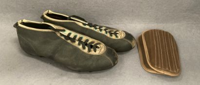 A pair of vintage football boots (possibly size 7/8) and a pair of shin pads