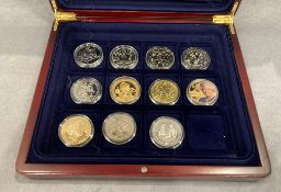 Wooden presentation box of £5 coins and others (11)