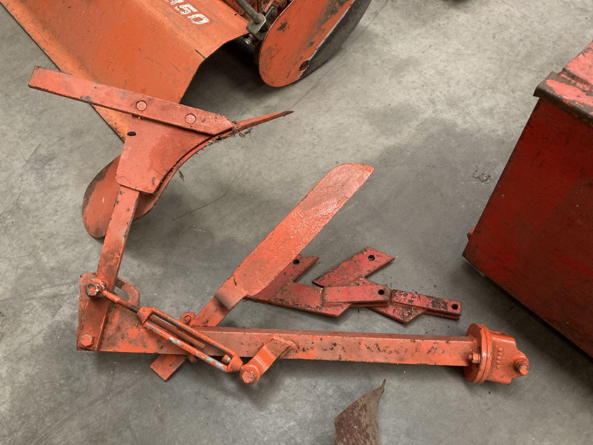 Orange painted single furrow plough *Please note,
