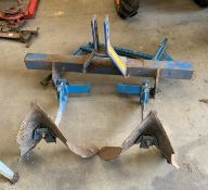 A blue metal frame TWO PLOUGH ATTACHMENT *Please note,