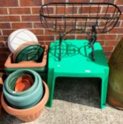 A child's outdoor green plastic table,