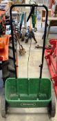 A Scotts Evergreen manual fertiliser spreader