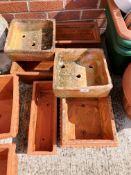 Six various terracotta planters