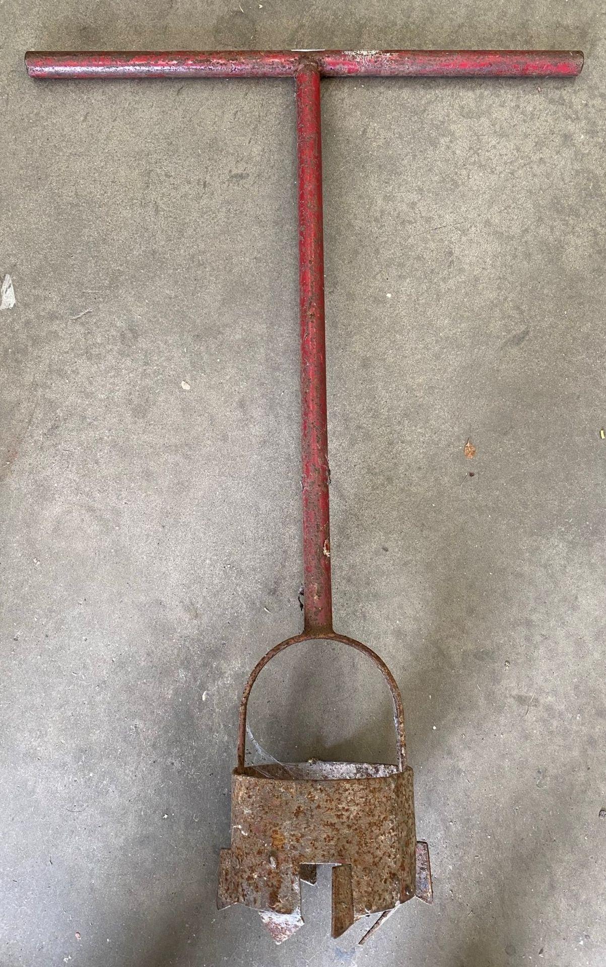 Red metal manual auger