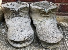 A pair of composition and concrete boot planters
