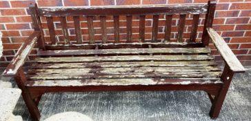 A wood garden bench 160cm long