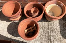 Eight large terracotta plant pots and a quantity of smaller terracotta plant pots