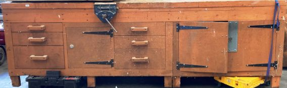 A substantial wood framed workbench with six drawers (do not open at present) and three drawers