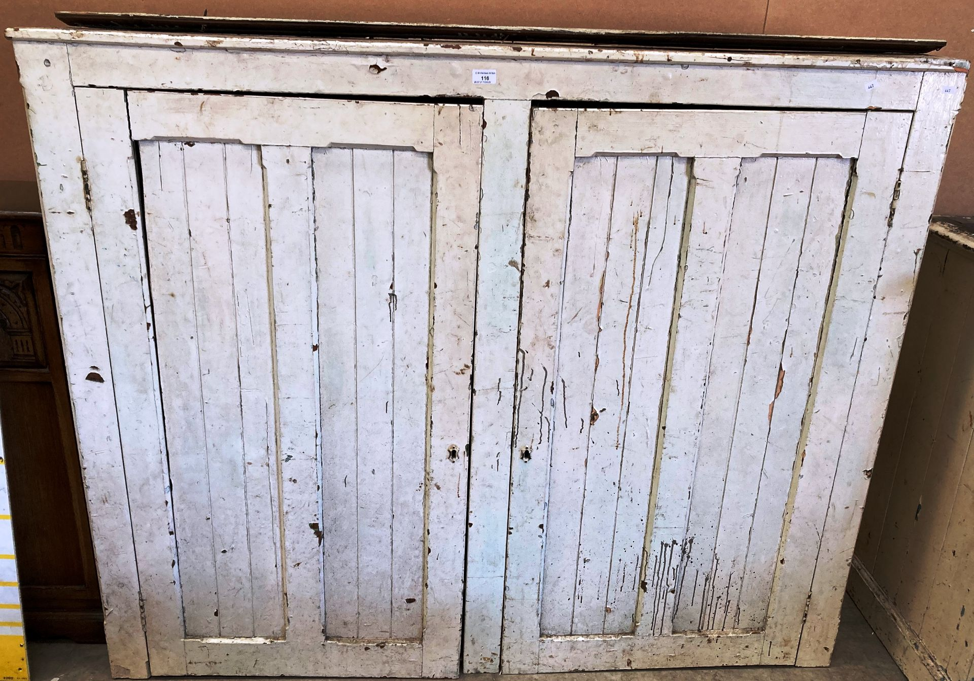 A white painted pine two door cabinet 152 x 32cm deep x 126cm high