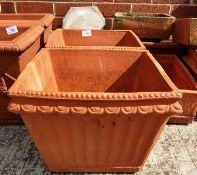 A pair of square terracotta planters each 30 x 30 x 23cm high