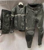Richa black leather motorbike jacket, size 44, a pair of Richa black leather motorbike trousers,