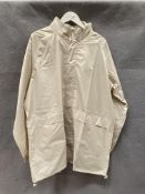 A Cotton Traders Packaway beige outdoor jacket,